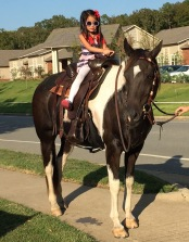 Nat was thrilled to get to ride Gorgeous our neighborhood horse again