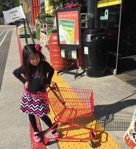 Whole Foods has little kid carts that Nat adores