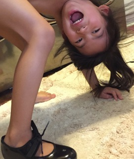 Excited about tying her shoe for the first time